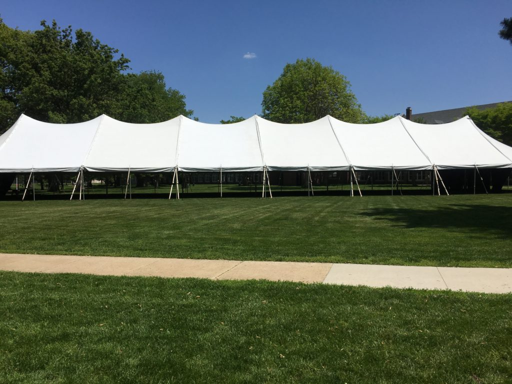 Side of the 40' x 160' rope and pole tent for commencement ceremony at Grinnell College 2016