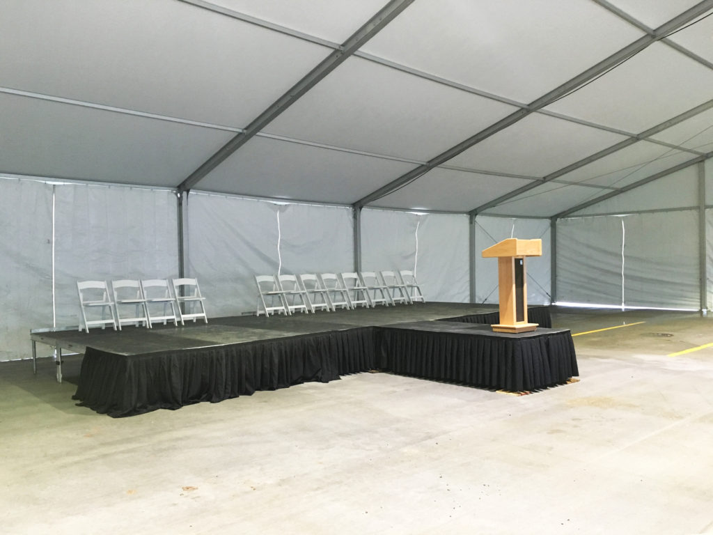 Stage and podium under the 60' x 98' Losberger tent setup for Ajinomoto North America Inc in Eddyville, Iowa