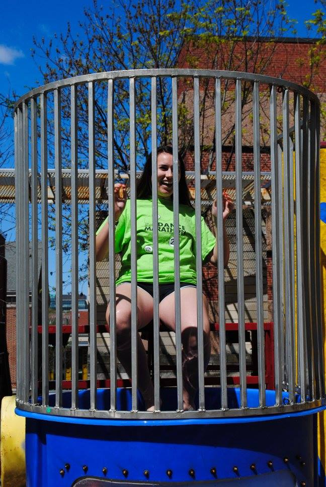 Student inside dunk tank at UIOWA Dance Marathon Summer Sendoff 2016