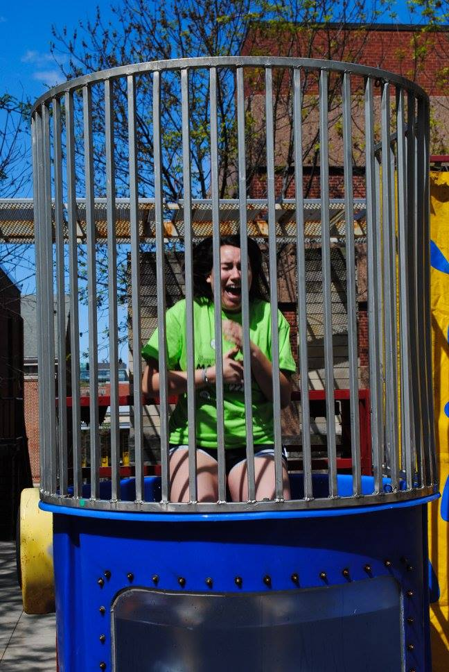 Student taking the plunge inside dunk tank at UIOWA Dance Marathon Summer Sendoff 2016