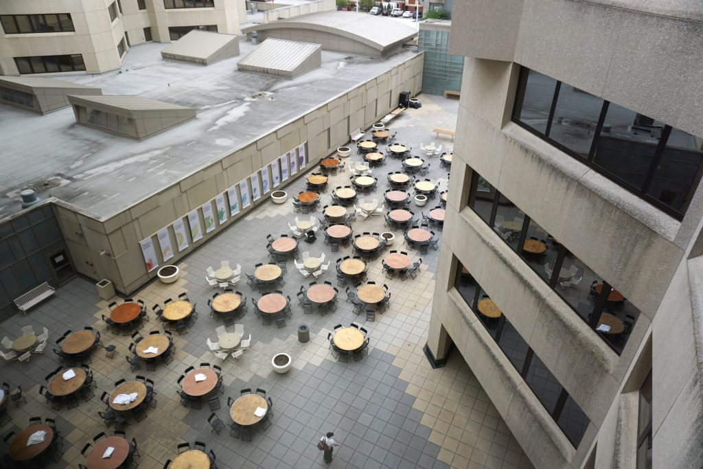 Aerial view of tables and chairs set up at University of Iowa Hospitals and Clinics courtyard