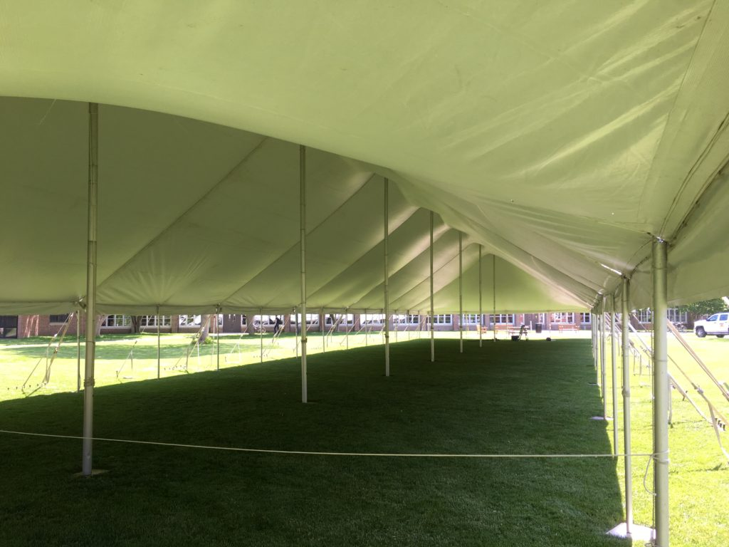 Under a 40' x 160' rope and pole tent for the commencement ceremony at Grinnell College 2016
