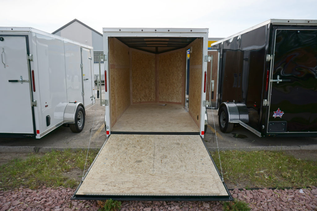 White 6'x10' enclosed cargo trailer Vin Number 2803 with back door open