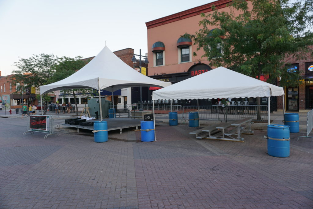 20'x20' Tentology and 20'x20' frame tent setup for the youth stage at Jazz Festival in Iowa City, IA
