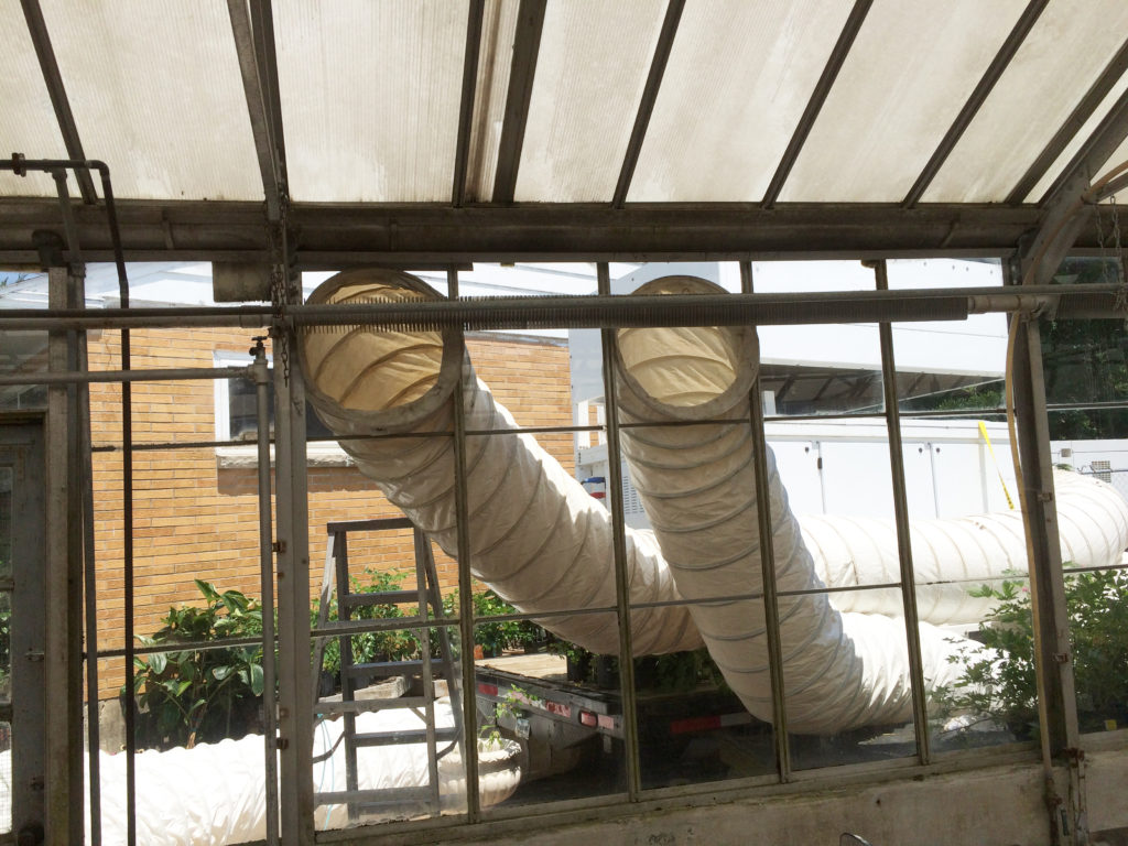 Air Conditioning ducts in window of greenhouse for a wedding in Iowa
