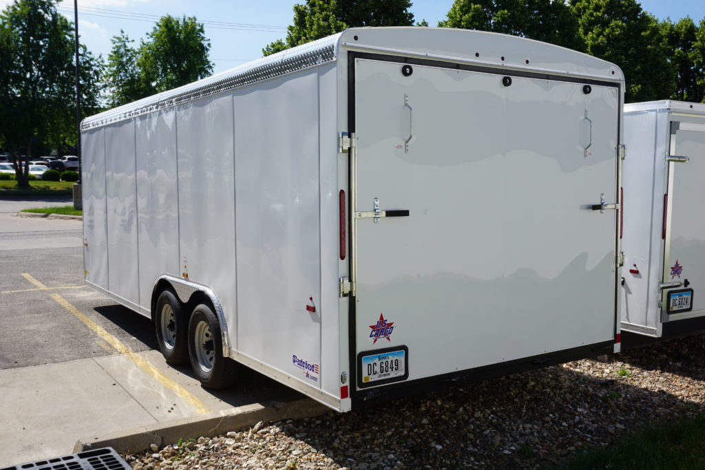 Back left of 8.5' x 20' white tandem enclosed trailer [sn2927]