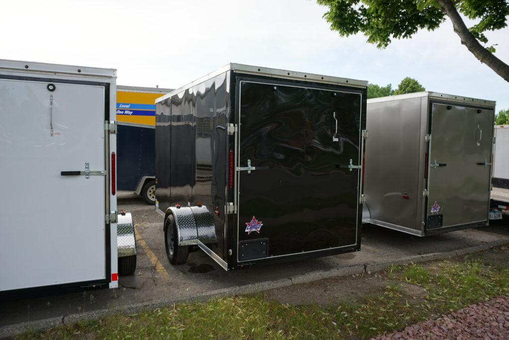 Back left of Black 6'x12' enclosed cargo trailer