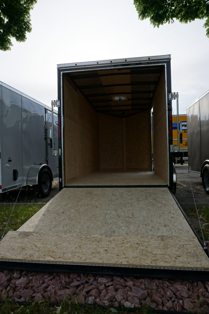 Back of Black 6'x12' enclosed cargo trailer