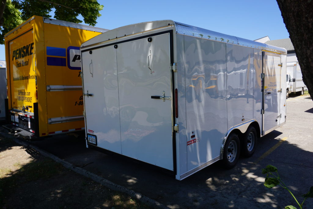 Back right of 8½x16 white tandem enclosed trailer for rent or sale [sn2488]