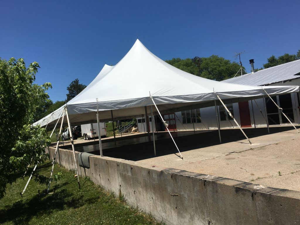 End of 40u0027x60u0027 Rope and Pole Tent with concrete wall obstruction at an & Tent/Outdoor Wedding Reception in Columbus Junction Iowa