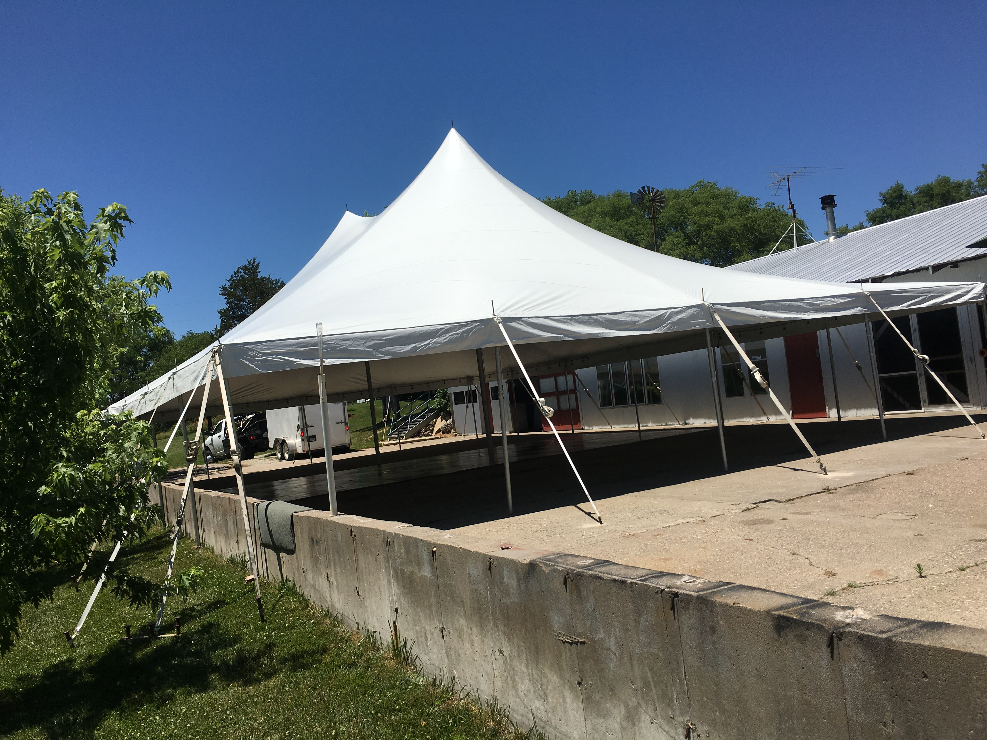 End of 40u0027x60u2032 Rope and Pole Tent with concrete wall obstruction at an outdoor wedding reception in Columbus Junction IA & End of 40u0027x60u0027 Rope and Pole Tent with concrete wall obstruction ...