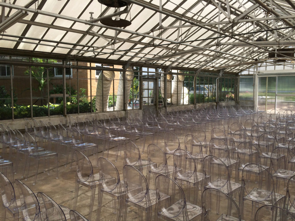 Inside the greenhouse with chairs for wedding. See Air Conditioning ducts in windows