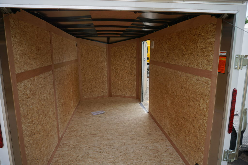 Inside with side door open White 6'x12' enclosed cargo trailer Vin Number 2831