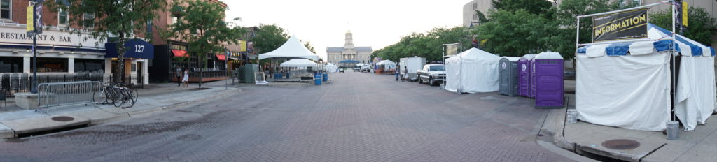 Jazz festival setup in downtown Iowa City, IA with tents and stages