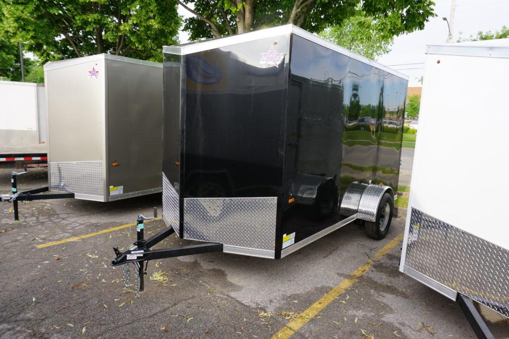 Left side of Black 6'x12' enclosed cargo trailer