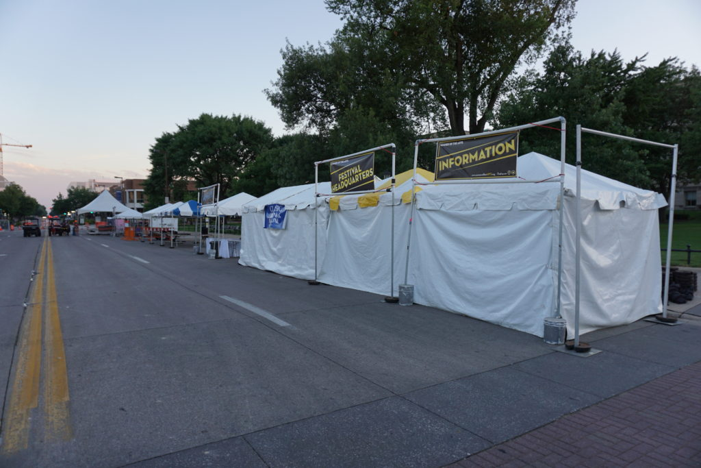 Multiple frame tents set up for the 2016 Jazz Festival in Iowa City