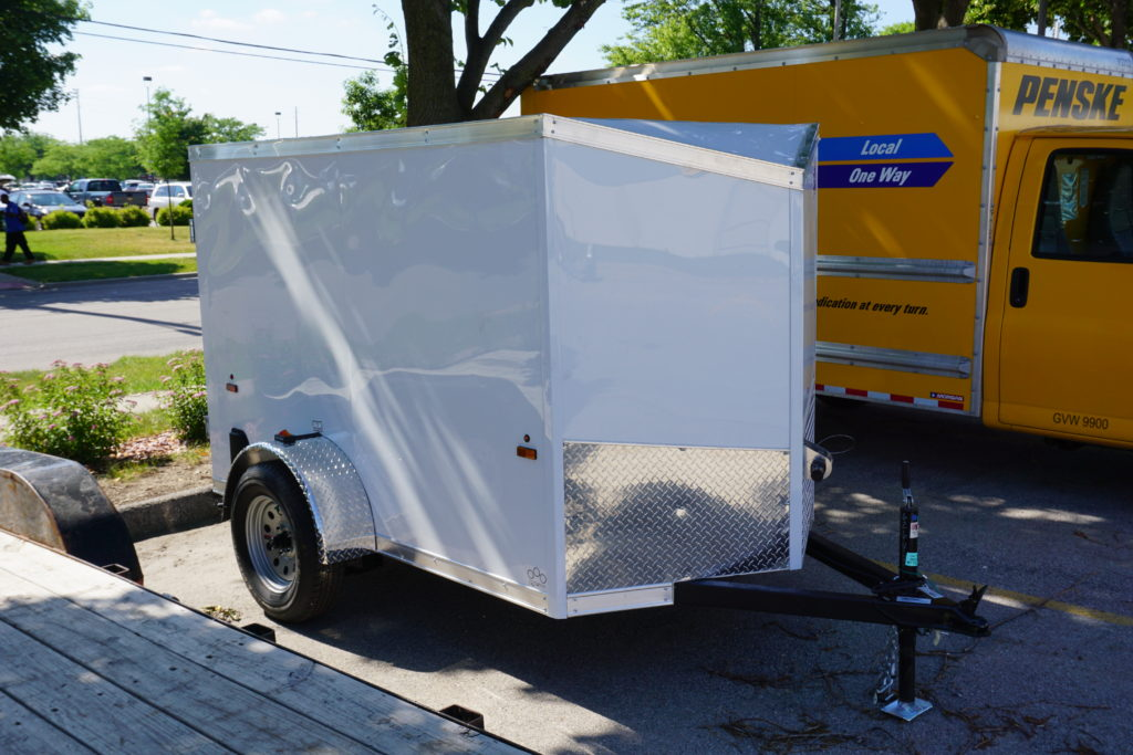 Right side of 5' x 8' white single axle enclosed trailer for rent or sale sn2643