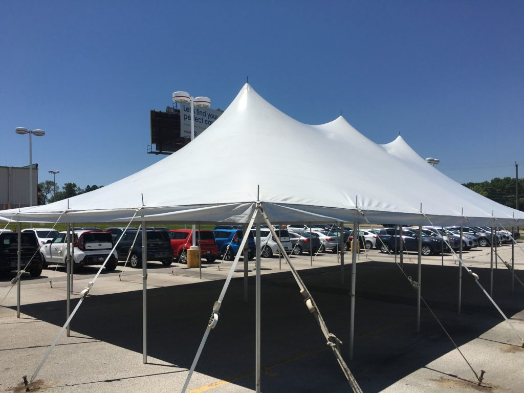 Rope and pole tent at dealership tent sale