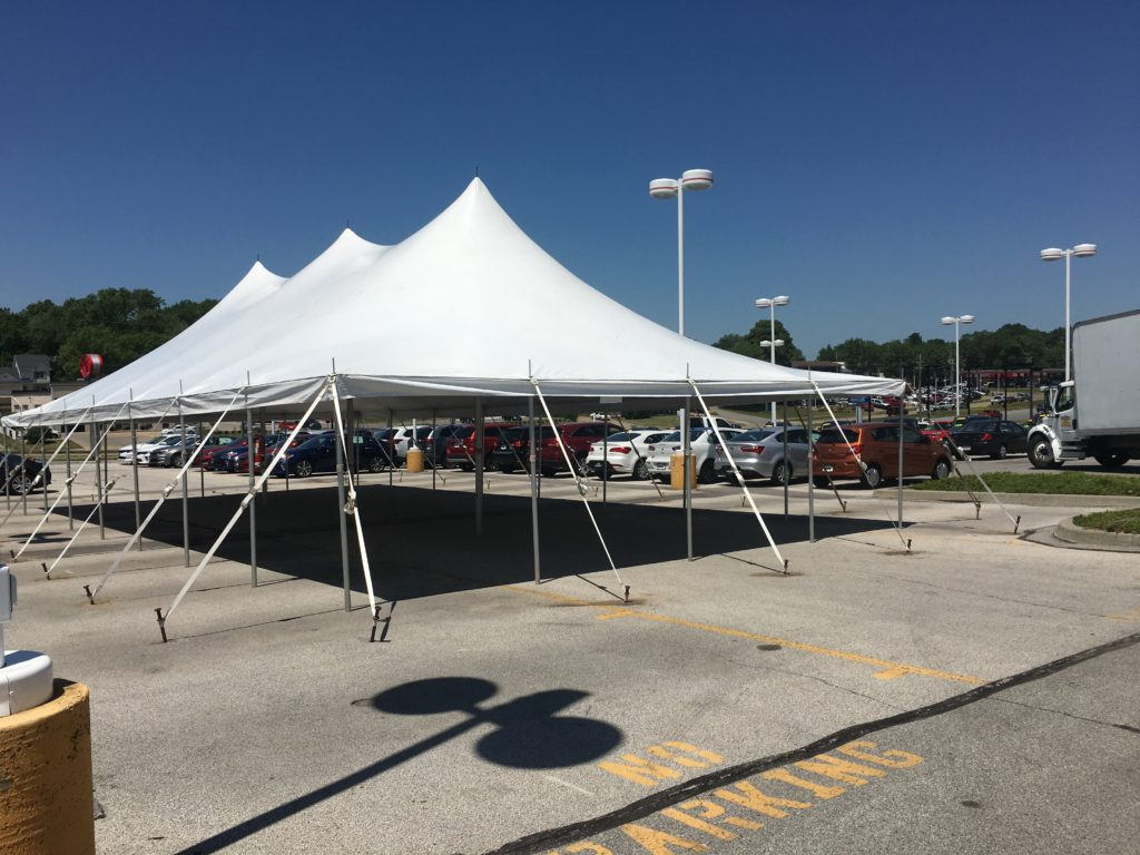 Setup for car dealership tent sale for Kia Motors in Des Moines, Iowa