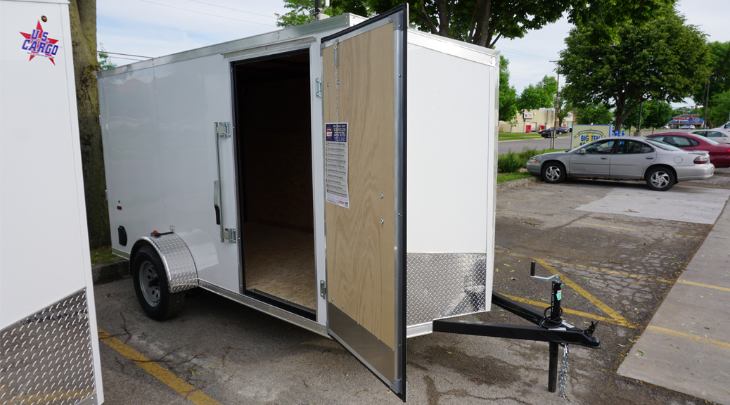 White 6'x12' enclosed cargo trailer Vin Number 2831 front door open