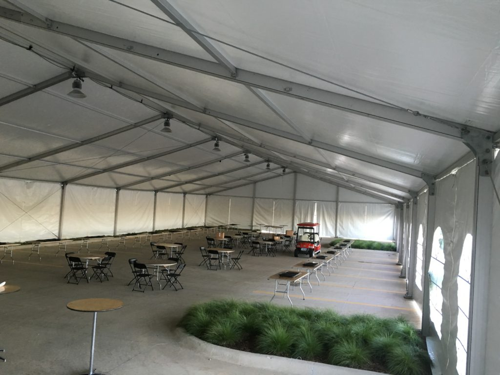 Inside the 60' x 131' Clearspan tent for the grand opening event of Brownells location in Grinnell, Iowa with French and regular sidewalls