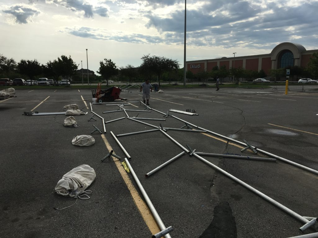 Laying out frame tents at Scheels in Des Moines, Iowa