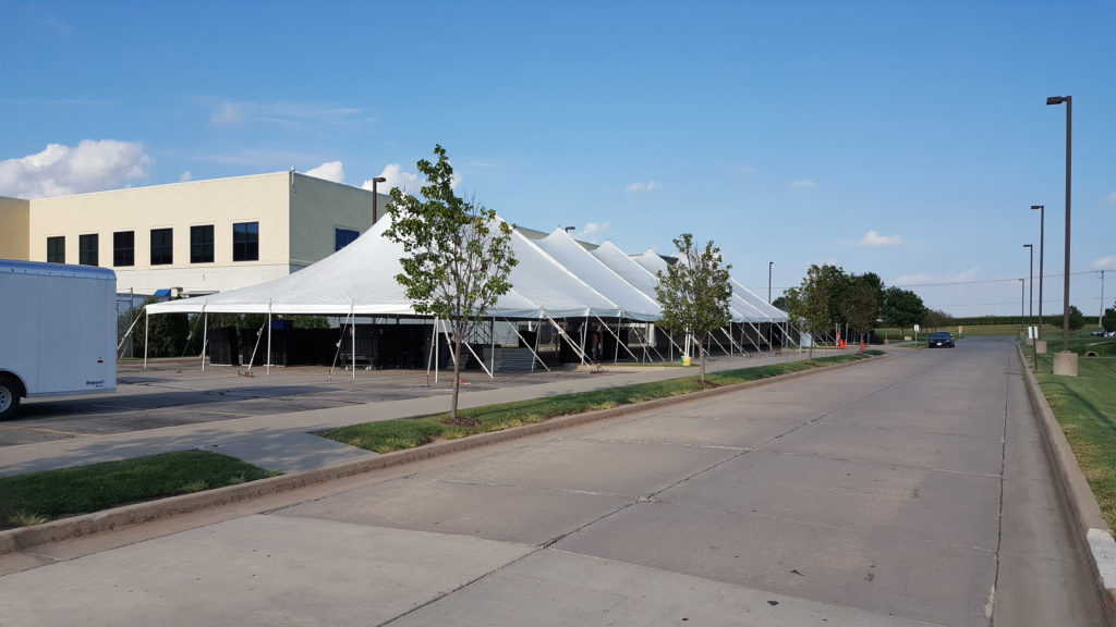 40' x 160' rope and pole tent with asphalt anchors at Nordstrom in Cedar Rapids, IA