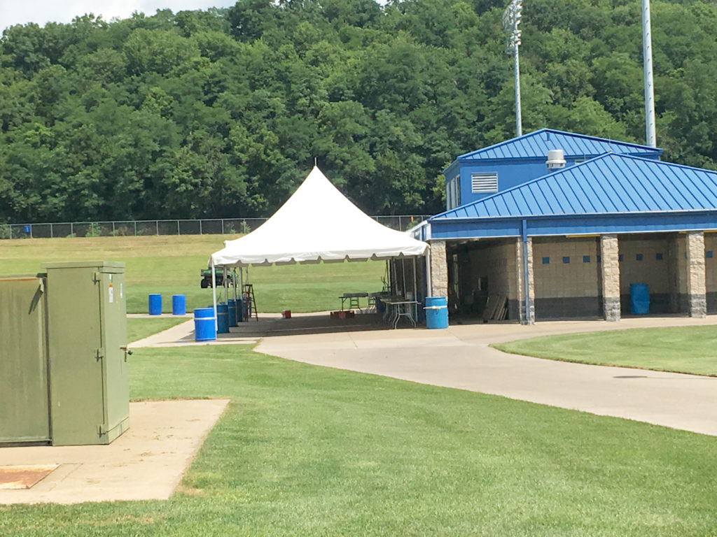 Frame tent with water barrels as ballast at the Muscatine Soccer Complex