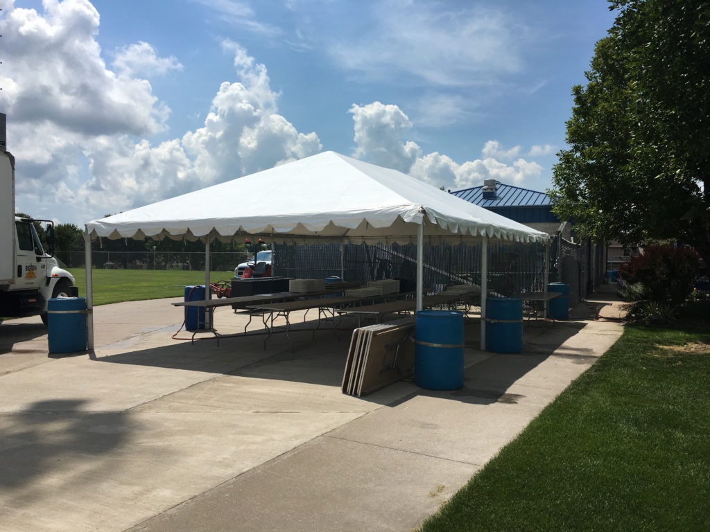 Frame tent with water barrels at the Muscatine Soccer Complex