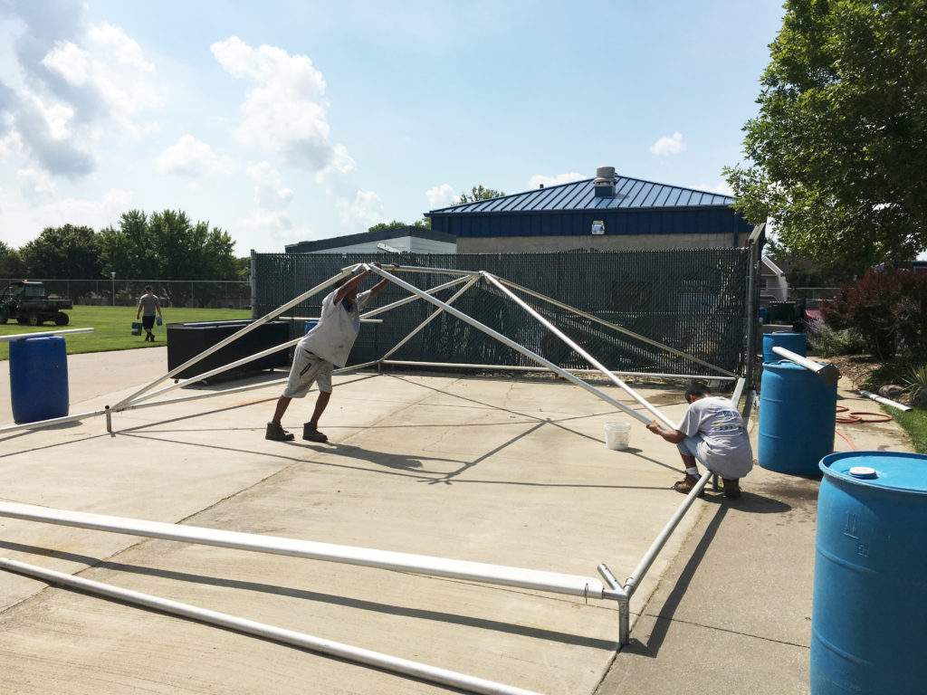 Putting the frame portion of a frame tent together at the Muscatine Soccer Complex