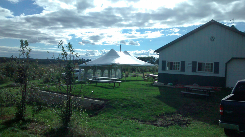 20' x 30' rope and pole tent with French window sidewalls at The Big Apple Orchard Mt Vernon, IA