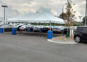 Finished 20′ x 30′ frame tent for the grand re-opening at Coralville Used Car Superstore