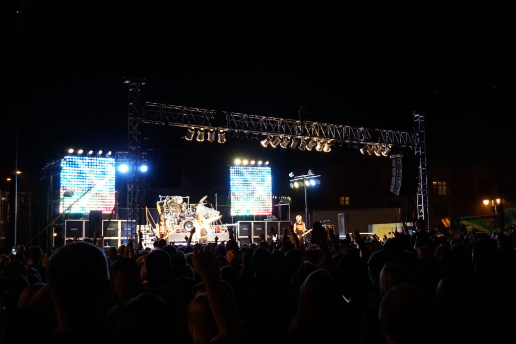 Full stage of Hairball cover band playing on stage at FRYfest block party