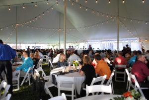 People seated under 60' x 90' rope and pole wedding tent