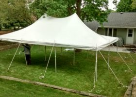 backyard party with a 20 x 30 rope and pole tent in iowa city