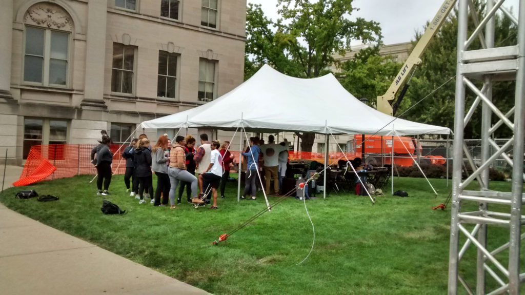 Students under our 20' x 30' rope and pole tent set up for SCOPE Productions: University of Iowa