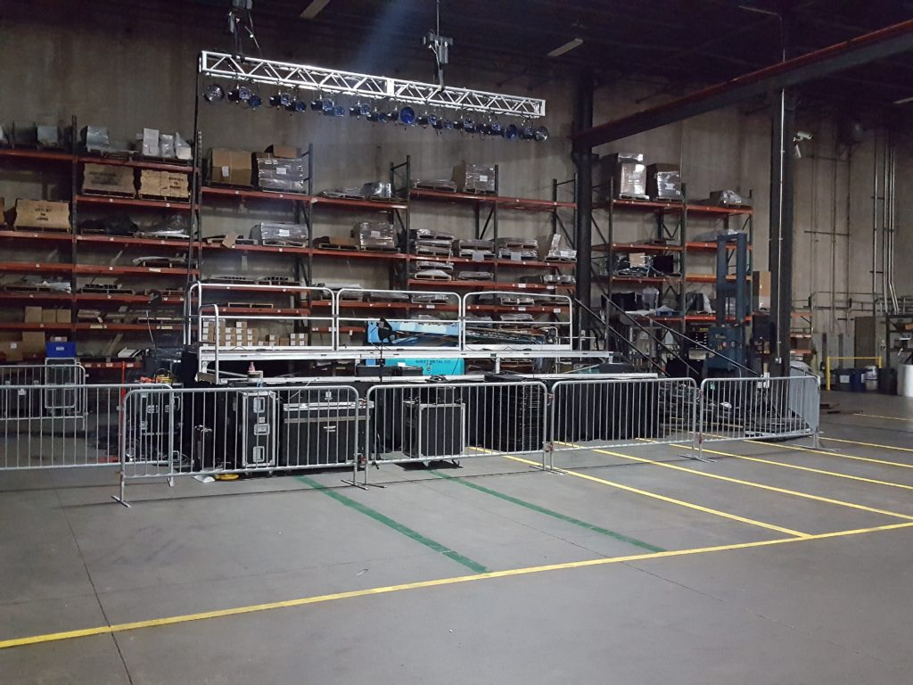 Tiered stage and barricade for political event at Giese Manufacturing being setup