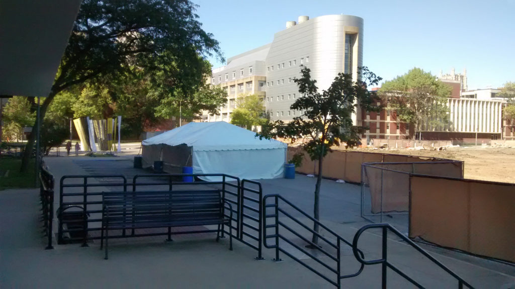 University of Iowa had us set up a 20' x 40' frame tent with water barrels between Rienow Hall and Quadrangle Hall in Iowa City