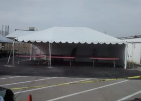 20′ x 30′ frame tent with tables for Morris & Company Entertainment in Davenport, Iowa