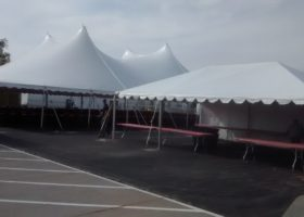 60′ x 90′ rope and pole tent and 20′ x 30′ frame tent with tables for Morris & Company Entertainment in Davenport, Iowa