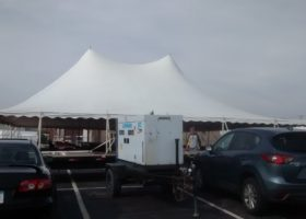 60kw Generator and 60′ x 90′ rope and pole tent for Morris & Company Entertainment in Davenport, Iowa