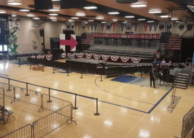 Event setup for Hillary Clinton political rally in Des Moines at Pomerantz Gymnasium