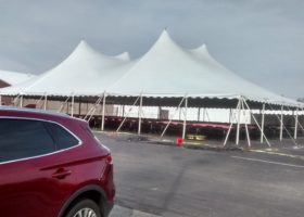 Outside of 60′ x 90′ rope and pole tent for Morris & Company Entertainment in Davenport, Iowa
