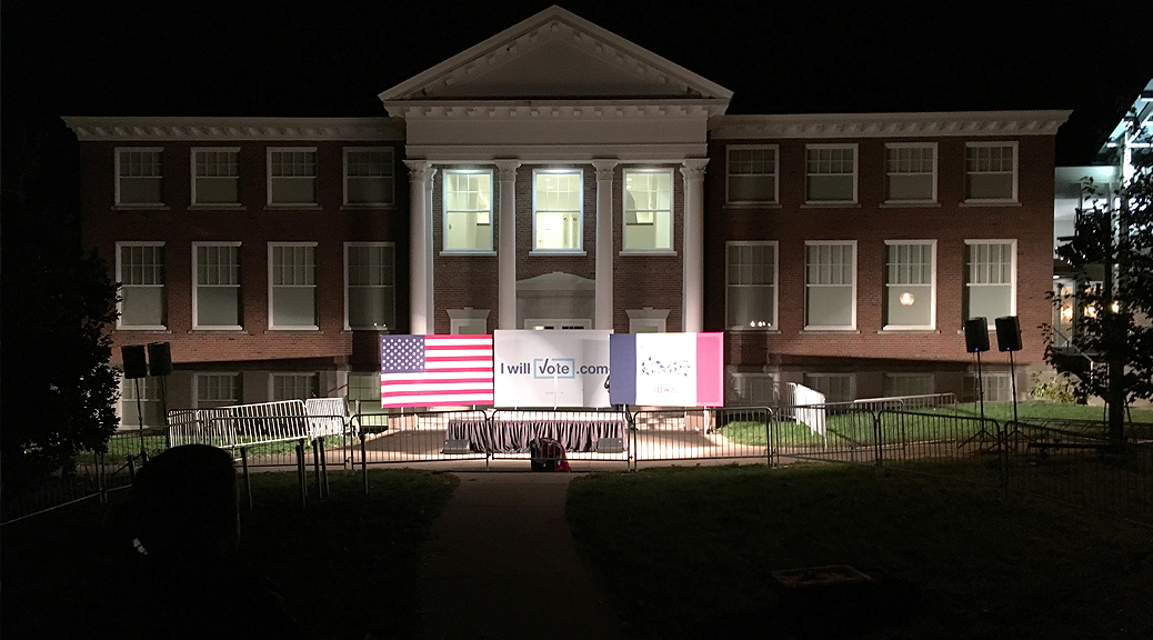 Political rally event setup for Bill Clinton in front of Armstrong Hall at Cornell College