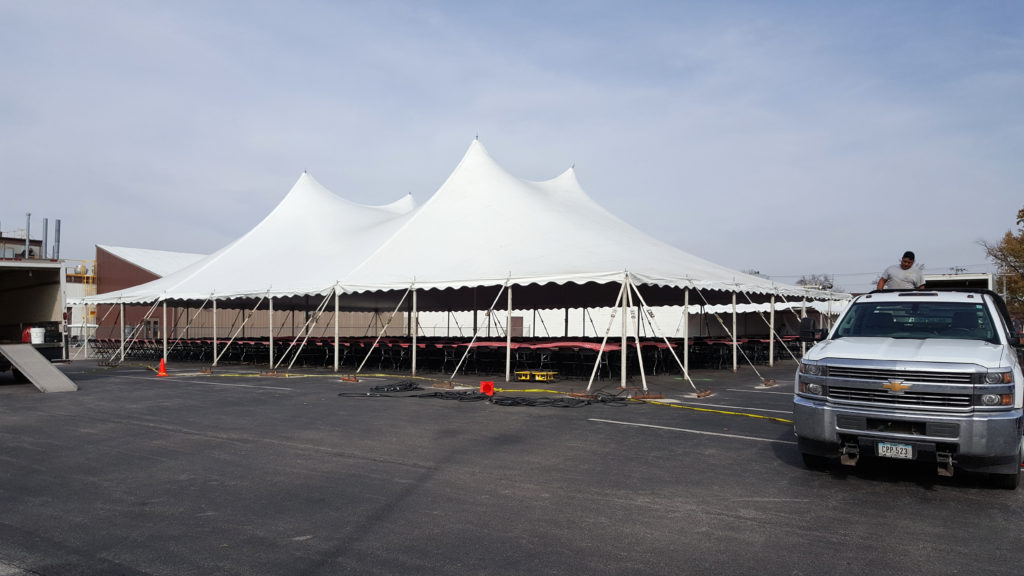 Seating for 500 under a large rope and pole tent in Davenport, IA