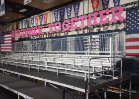 Setup of several 5-row elevated bleacher for Hillary Clinton political rally event