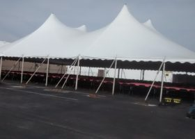 Side of 60′ x 90′ rope and pole tent for Morris & Company Entertainment