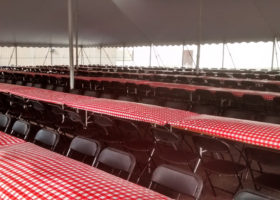 Under the 60′ x 90′ rope and pole tent for Morris & Company Entertainment in Davenport, Iowa