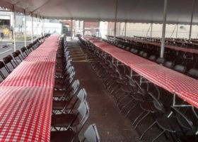 Under the 60′ x 90′ rope and pole tent with tables for Morris & Company Entertainment in Davenport, Iowa
