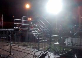 Two levels of press risers with stairs setup for political event at Larsen Park Road, Sioux City, Iowa